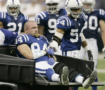 Indianapolis Colts linebacker Rob Morris (94) is greeted by linebacker Freddie Keiaho (54) after being injured on a play during the second quarter of the Denver-Indianapolis game, won by Indianapolis, 38-20.